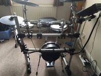 roland.............electric drums.......... yamaha dtx900