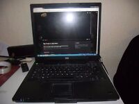 HP COMPAQ laptop DUAL CORE nx6325 fully working recent new battery and Blu Ray player