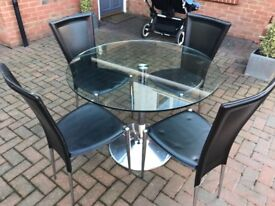 Glass round table and 4 black leather effect chairs