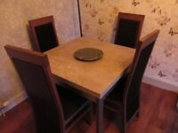 4 black and wooden dinning room chairs
