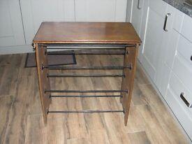 A 20th century mahogany shoe rack made by John Watt of Sheffield.