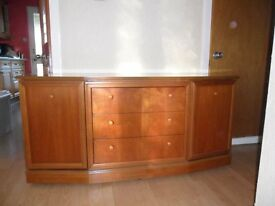 Wooden sideboard . Two side cupbaords with one shelf. Three drawers down front. Very good condition