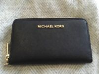 Michael Kors genuine black purse with wrist strap