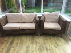 Conservatory 2 seater sofa and chair. Brown wicker with beige cushions. Used but in good condition