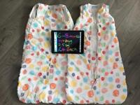 Various second hand baby girls clothes, sleeping bags and crib sheets