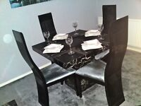 Solid marble dining table with four chairs