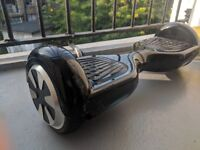 Hoverboard - classic black styling, hardly used. Great power & control; few scuffs. Includes charger