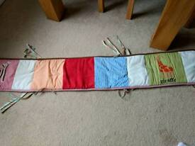 Cot bumper and hanging storage