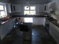 White painted solid wood kitchen units and island. Built in wine rack and extractor canopy included