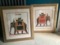 Pair of large framed elephant pictures