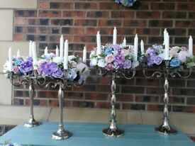 5 SILVER CANDELABRAS WITH PASTEL SILK FLOWERS & CANDLES