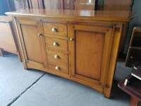 Large pine four drawer sideboard