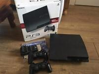PlayStation 3 (160GB) w. 2 controllers, charging dock and 20 games