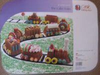2 new Nordicware novelty cake tins- train and ice cream cornet