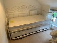 Laura Ashley white metal frame single day bed with full size pull out trundle. Mattresses included