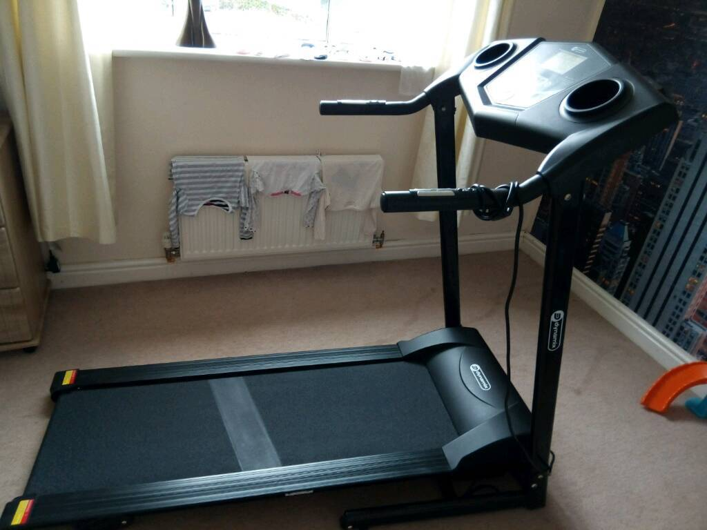 Dynamic motorized treadmill