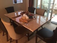 Dining table and 6 chairs in mint condition