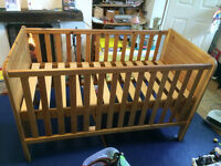 Cot bed with adjustable height setting