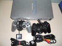 Playstation 2 with 2 controllers, optional games