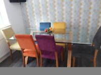 6 seater glass table with 6 chairs