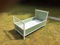 CHILD COT/BED. A low level cot with sides which can be removed as your child grows