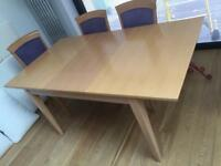 Extending dining room table and 6 chairs (4 dining and 2 carver chairs)