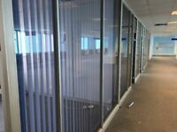 Glazed office partitions with tinted glass walls and doors buyer dismantles and takes away