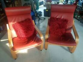Red leather IKEA POANG chairs with cushions