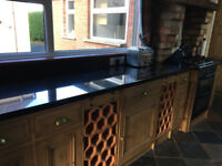 Solid Pine Kitchen units with black granite worktops and belfast sink