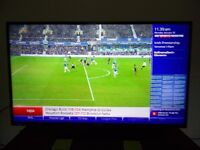Blaupunkt 50 inch HD Tv television with remote and new sealed wall mount - excellent condition