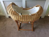 Mothercare wicker basket with lining, mattress and rocking stand.