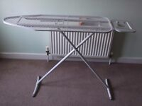 white mesh ironing board
