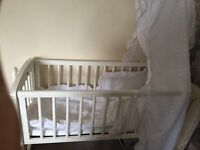 Mothercare swinging crib , mattress and bedding