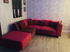Reduced pink corner sofa