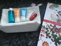 Clarins brand new bag with skin care products and christmas bag