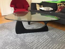Coffee table - glads top with black base