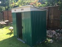 Green metal garden shed