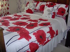 2 sets of poppy double duvets covers +7.5 tog duvet + cushions
