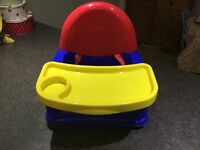 Chair booster seat with tray