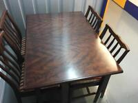 Stag extendable dining table with four chairs