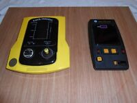 VINTAGE 1980's PUCK MONSTER AND SPACE INVADER HAND HELD ARCADE GAMES.