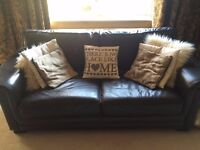large 3 seater sofa , brown/black slight damage to one arm but doesn't stand out .
