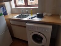 Used Kitchen Cabinet, stove, exhaust fan and sink for free .
