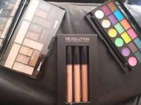 Revolution make up to pallets and one lipgloss cover sticks