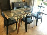 Glass and walnut dining table