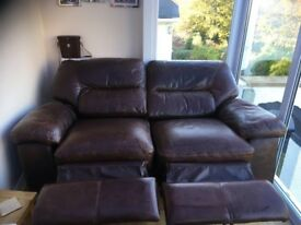 2 seater, Brown leather sofa. Electric recliner full working order. £50
