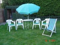 Patio Set. Four Chairs with seat Cushions, Metal Table, Parasol and a Deckchair. Can Deliver.