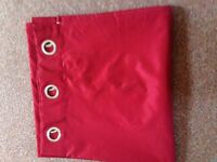 Pair of red curtains. ideal for a big window of house