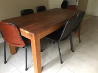 Teak dining table with industrial leather chairs
