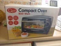Small compact , 800 watt oven. Unused and still boxed.